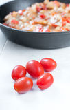 Cherry tomatoes with dish cooked Royalty Free Stock Photos