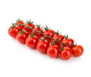 Cherry Tomatoes fresco maduro no ramo isolado no fundo branco Fotos de Stock