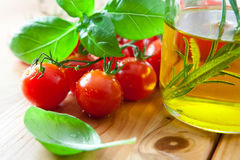 Cherry tomatoes,fresh basil and olive oil Royalty Free Stock Photography