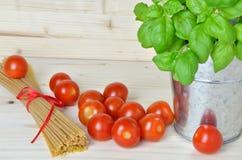 Cherry tomatoes, fresh basil and spaghetti Stock Image