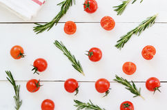 Cherry tomatoes and fresh rosemary on white background Stock Image