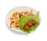 Cherry tomatoes, fried potatoes and lettuce in  white plate isol Royalty Free Stock Images