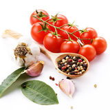 Cherry tomatoes garlic and bay leaf Royalty Free Stock Photo