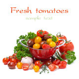 Cherry tomatoes, garlic and fresh herbs, isolated Stock Photo