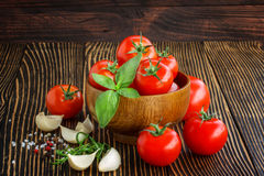 Cherry tomatoes, garlic,  pepper,salt ,rosemary and basil   over Royalty Free Stock Photo