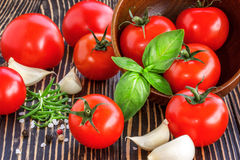 Cherry tomatoes, garlic,  pepper,salt ,rosemary and basil   over Royalty Free Stock Photography