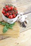 Cherry tomatoes, garlic and spaghetti Stock Photo