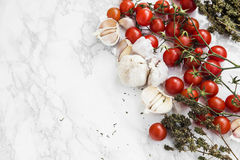 Cherry tomatoes, garlic, thyme herb Royalty Free Stock Images