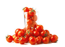 Cherry tomatoes in a glass. The glass is filled with cherry tomatoes Stock Image