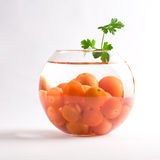 Cherry tomatoes in a glass aquarium. Over white background stock photography