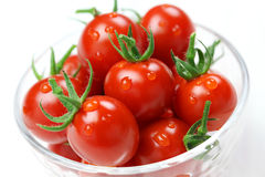 Cherry tomatoes in glass bowl Stock Images