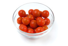 Cherry tomatoes in a glass bowl. On white background Royalty Free Stock Photos