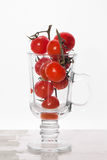 Cherry tomatoes on glass cup Stock Photos