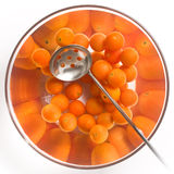 Cherry tomatoes in a glass salad bowl. Over white background royalty free stock image