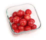 Cherry tomatoes. In grass crisper isolated on white background Royalty Free Stock Image