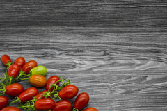 Cherry tomatoes on a gray table Stock Images