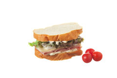 Cherry tomatoes and ham on french. Stock Photography