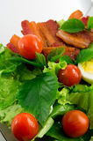 Cherry tomatoes, herbs, olive oil, eggs and bacon Stock Photos