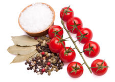 Cherry tomatoes with herbs and sea salt. Cherry tomatoes with herbs (color pappercorn and bay leaves) and sea salt in wooden bowl Stock Images