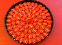 Cherry tomatoes with herbs and spices Stock Photography
