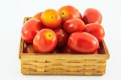 Cherry Tomatoes i en korg på vit bakgrund Royaltyfria Bilder