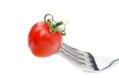 Cherry tomatoes impaled on a fork isolated Stock Image