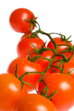 Cherry tomatoes isolated over white Royalty Free Stock Images