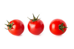 Cherry tomatoes isolated on white background. Cherry tomatoes. Three cherry tomatoes isolated on white background Royalty Free Stock Image