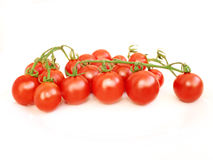 Cherry tomatoes isolated on the white Royalty Free Stock Images
