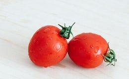 Cherry tomatoes on the kitchen table stock photos