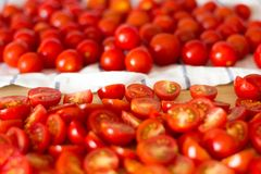 Cherry tomatoes on the kitchen table. Stock Image