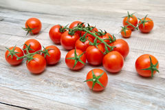 Cherry tomatoes lie on a wooden table. Royalty Free Stock Photography
