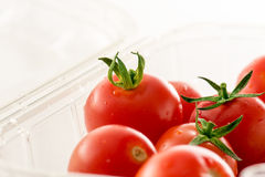 Cherry tomatoes on market package Stock Photos
