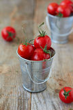 Cherry tomatoes. In metal pails Royalty Free Stock Photography