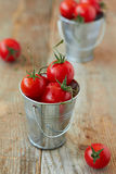 Cherry tomatoes. In metal pails Royalty Free Stock Image