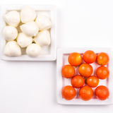 Cherry tomatoes and mozarella on white background. Light dinner made of cheese and vegetables Stock Images