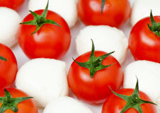 Cherry tomatoes with mozzarella. Cherry tomatoes and baby mozzarella – close-up Royalty Free Stock Photo