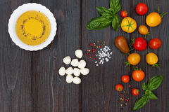 Cherry tomatoes, mozzarella, basil leaves, spices and olive oil from above. Italian caprese salad recipe ingredients Royalty Free Stock Photos