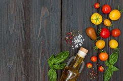 Cherry tomatoes, mozzarella, basil leaves, spices and olive oil from above. Italian caprese salad recipe ingredients Royalty Free Stock Images
