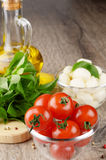 Cherry tomatoes, Mozzarella and oil Royalty Free Stock Photo