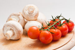 Cherry tomatoes and mushrooms Royalty Free Stock Images