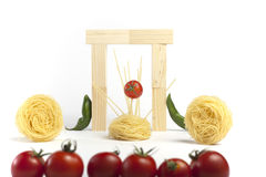 Cherry tomatoes in music idol.Spagheti. Royalty Free Stock Image