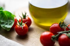 Cherry tomatoes and oil stock photography