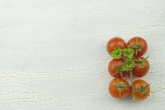 Cherry tomatoes on old shadowed platter. Stock Image