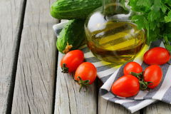 Cherry tomatoes, olive oil and parsley Stock Photo