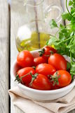 Cherry tomatoes, olive oil and parsley Stock Images
