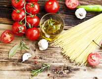 Cherry Tomatoes, Olive Oil,Pasta and Spices,Mediterranean Ingred Royalty Free Stock Photo