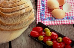 Cherry tomatoes and olives Stock Images