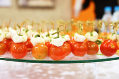 Cherry tomatoes olives cheese on wooden stick appetizer Stock Photos
