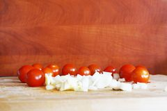 Cherry tomatoes and onions Royalty Free Stock Images